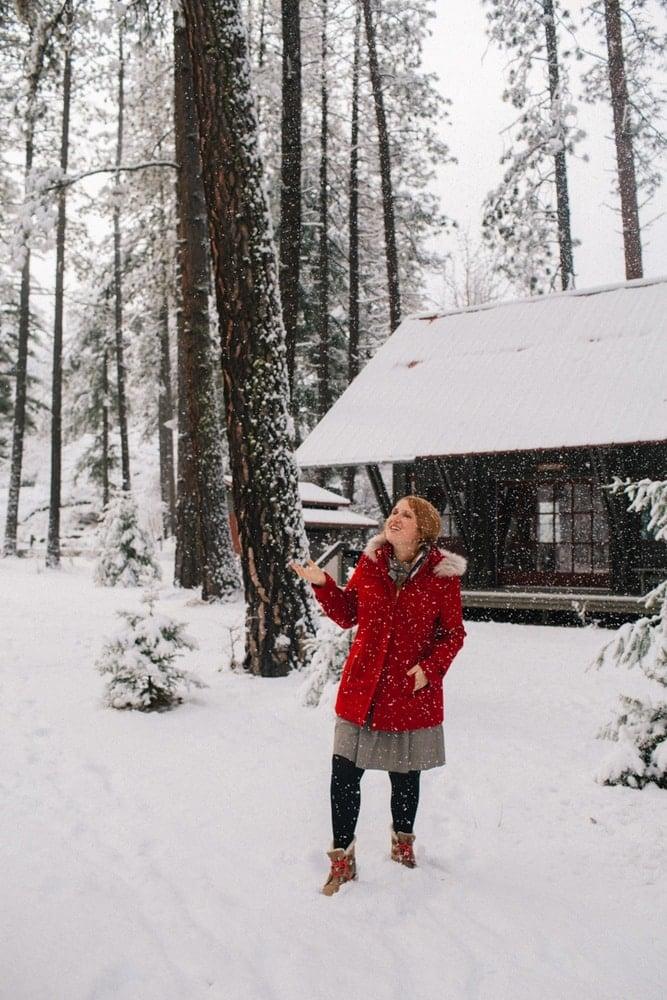 Kara in her red winter coat at Sleeping Lady Mountain resort in Leavenworth, Washington
